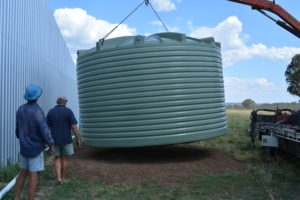 Water tank being installed at the back of the hangar